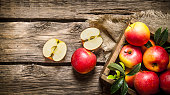 Fresh red apples in wooden box.
