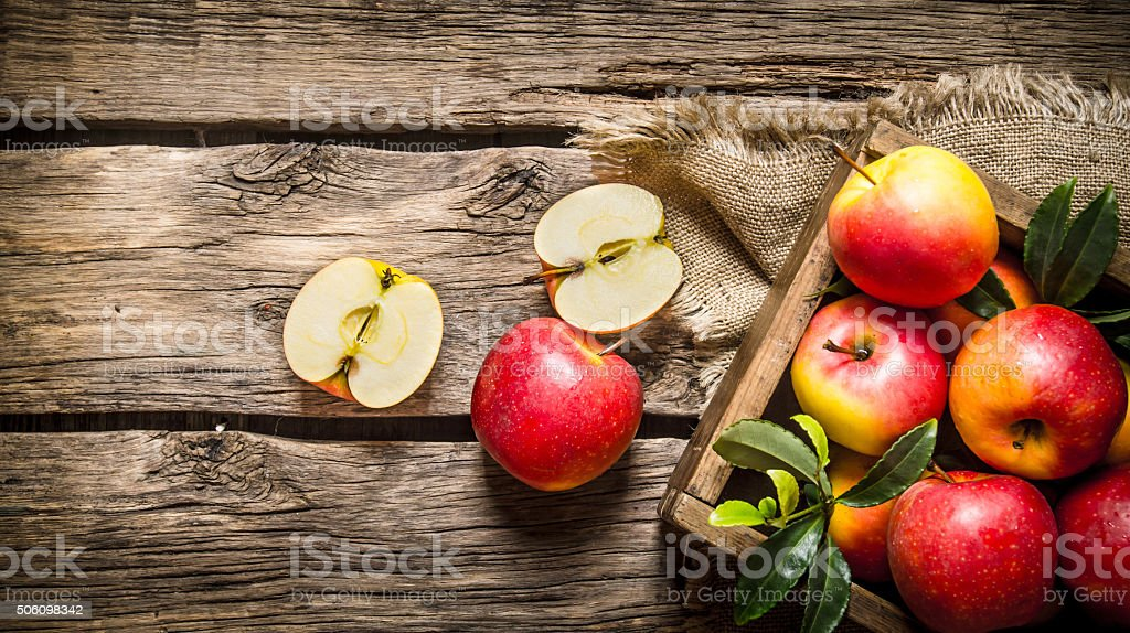 Fresh red apples in wooden box. stock photo