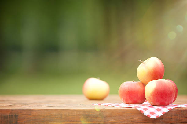 Fresh Red Apples on Wooden Table stock photo