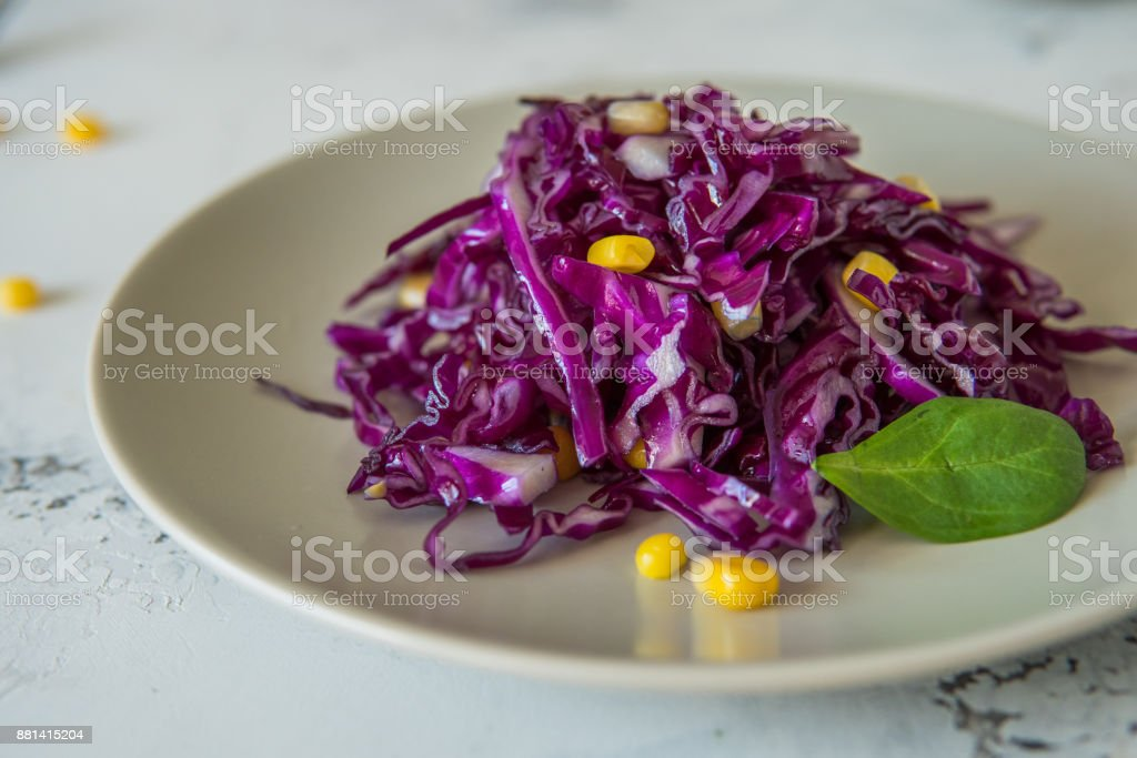 Fresh red cabbage salad with corn. Vegeterian and diet food stock photo