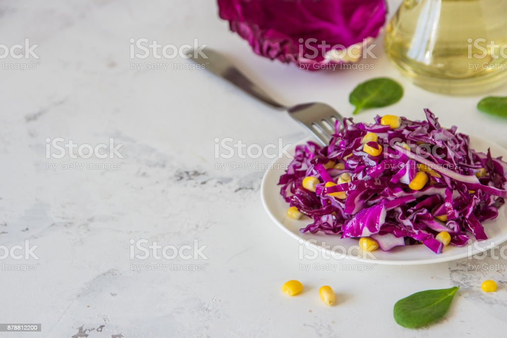 Fresh red cabbage salad with corn. Vegeterian and diet food. Space for text stock photo