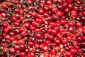 Fresh red cherries, full frame, high angle view. Retail display in an open air market stall. Lugo province, Galicia, Spain.