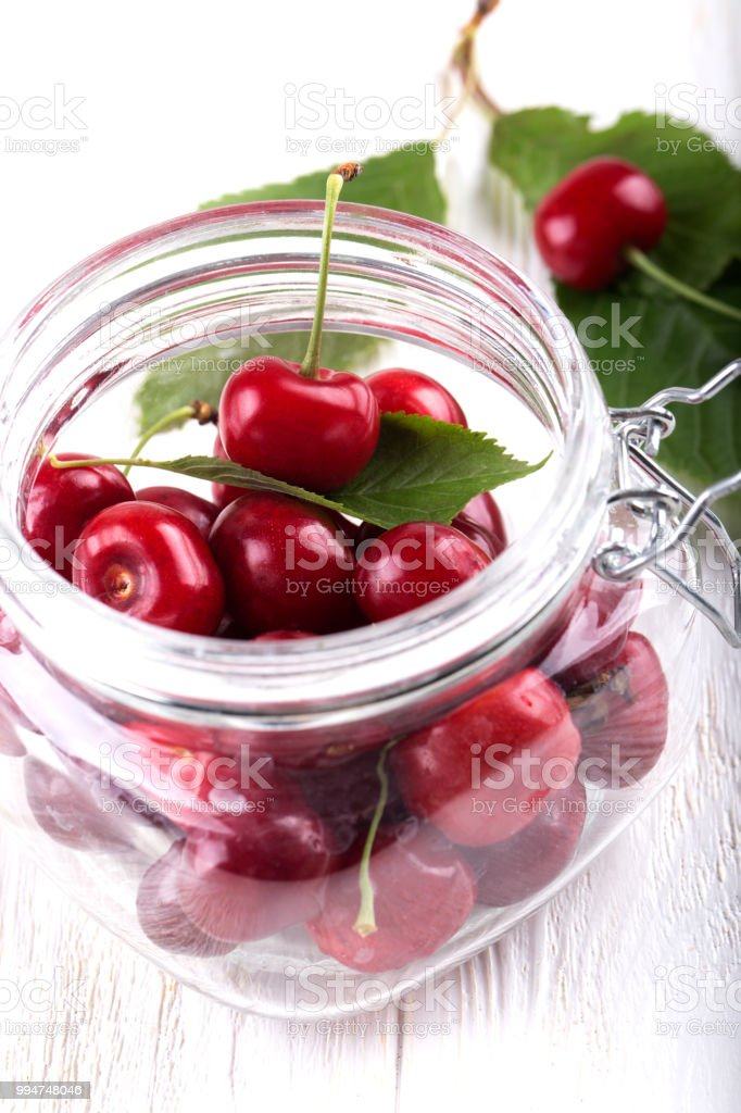 Fresh Red Cherries In Clear Glass Jar Close Up Whole A