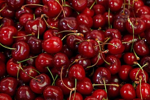 istock Fresh red cherries on retail market close up 1096469686