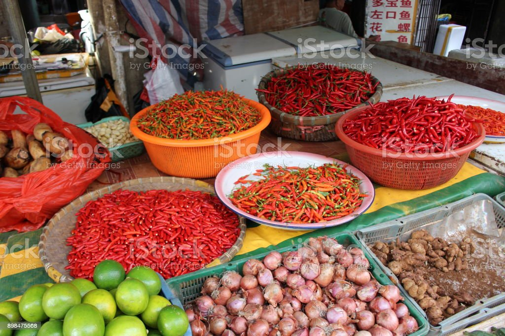 Fresh red chili peppers on the Asian street market in China. stock photo