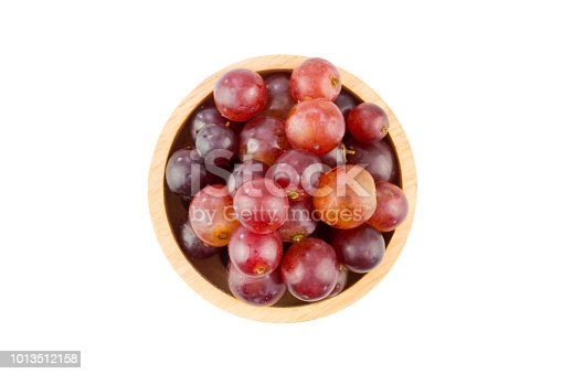 istock fresh red grape in bowl isolated on white background 1013512158