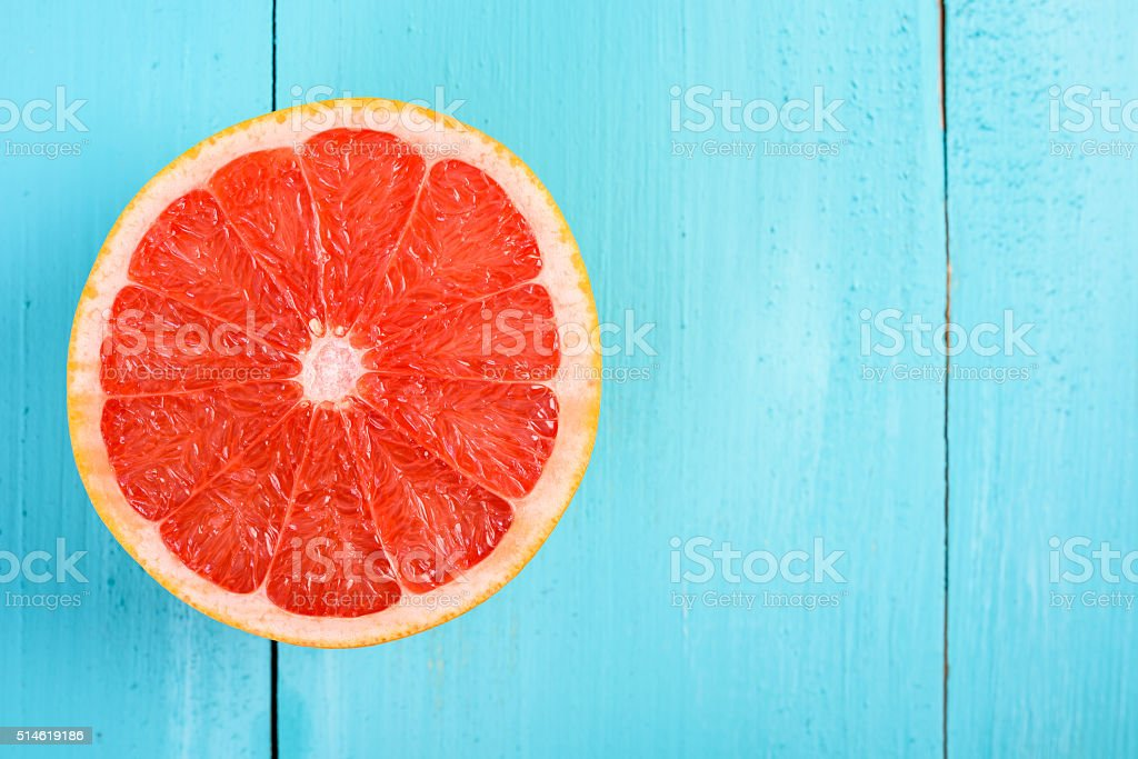 Fresh Red Grapefruit Slice On Table stock photo