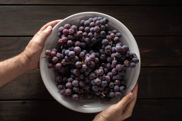 Fresh red grapes on bowl stock photo
