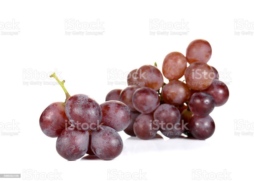 Fresh red grapes on white background Lizenzfreies stock-foto