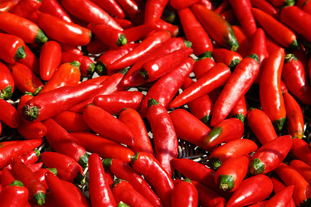 fresh red hot chilli peppers close-up​​​ foto