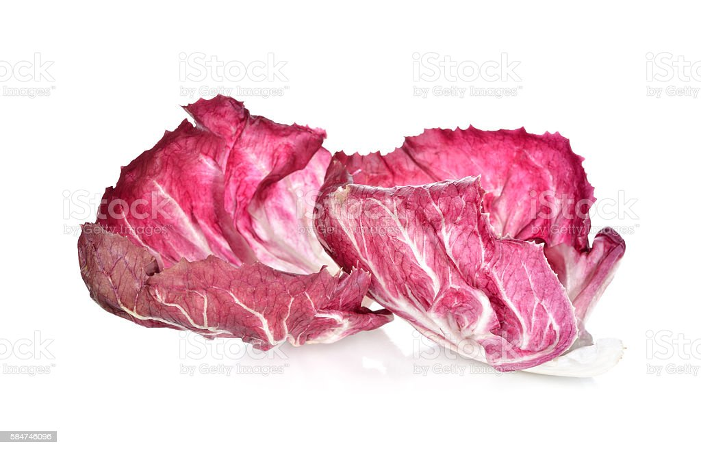 fresh red radicchio leaf on white background stock photo