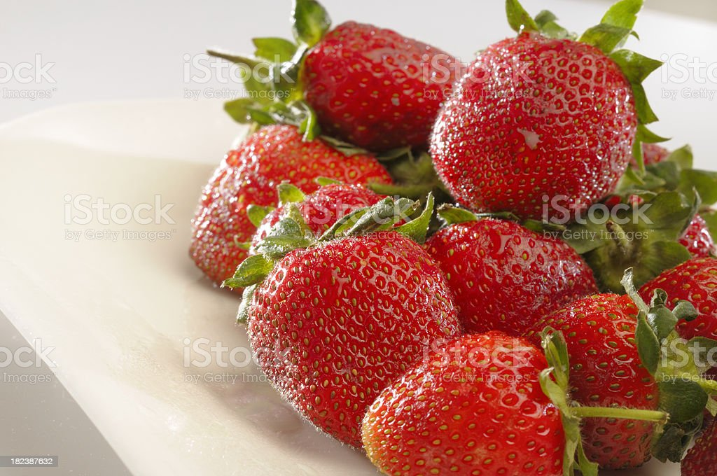 Fresh red strawberries with dew drops stock photo