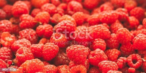 istock Fresh Red Sweet Berries Raspberries Background. 963418200