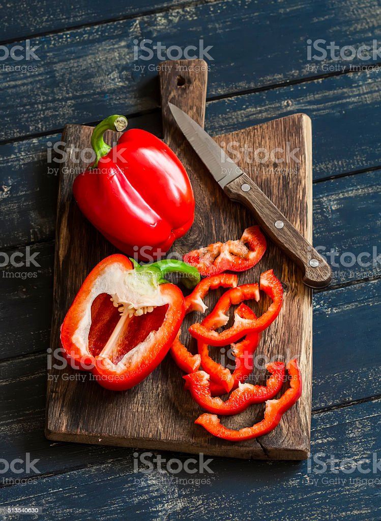 Fresh red sweet pepper on a wooden rustic board stock photo