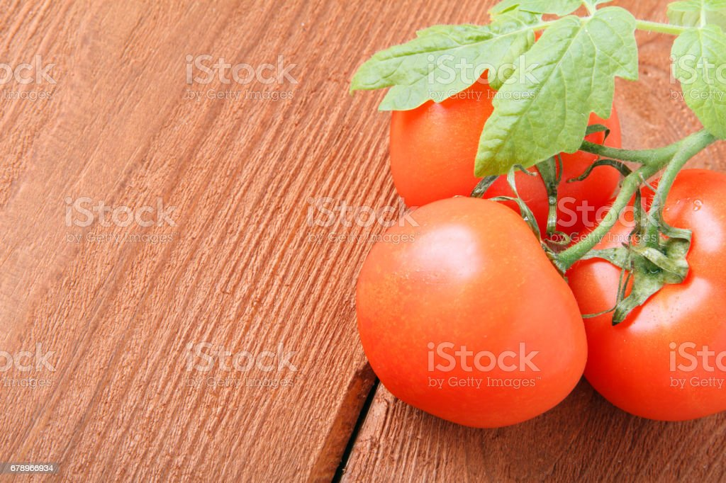 Fresh red tomatoes on wooden background. Place for text royalty-free stock photo