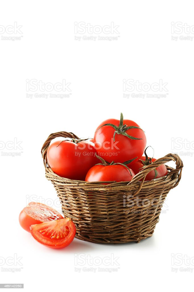 Fresh red tomatos in basket isolated on white stock photo