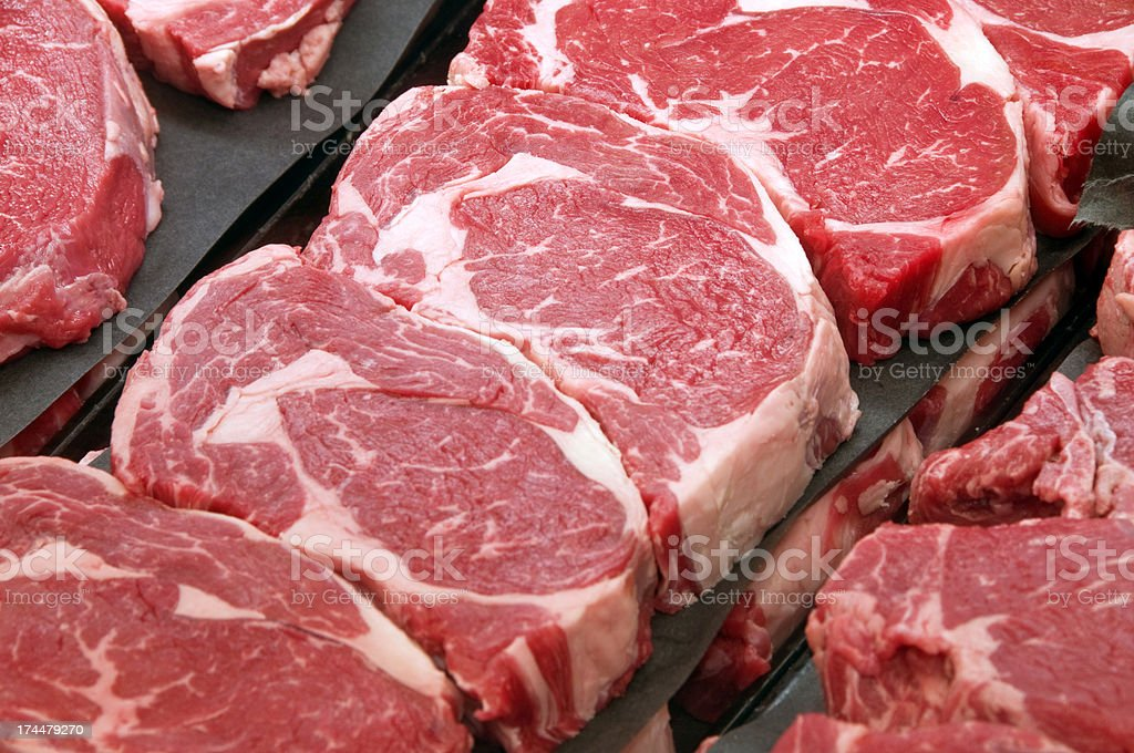 Fresh Ribeye Steaks at the Butcher Shop royalty-free stock photo