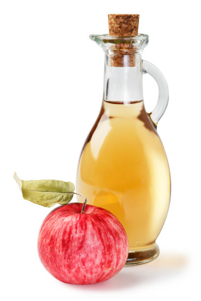Fresh ripe apples and apple cider vinegar. White background. Isolated white background. stock photo