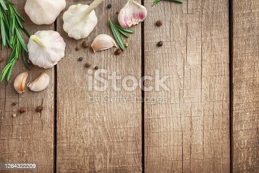 Fresh asparagus heap on wooden cutting board on wooden background. Top view. Copy space.