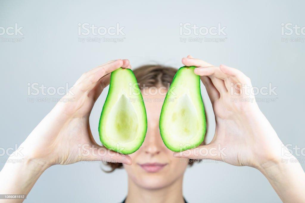 Fresh ripe avocado in woman hands stock photo