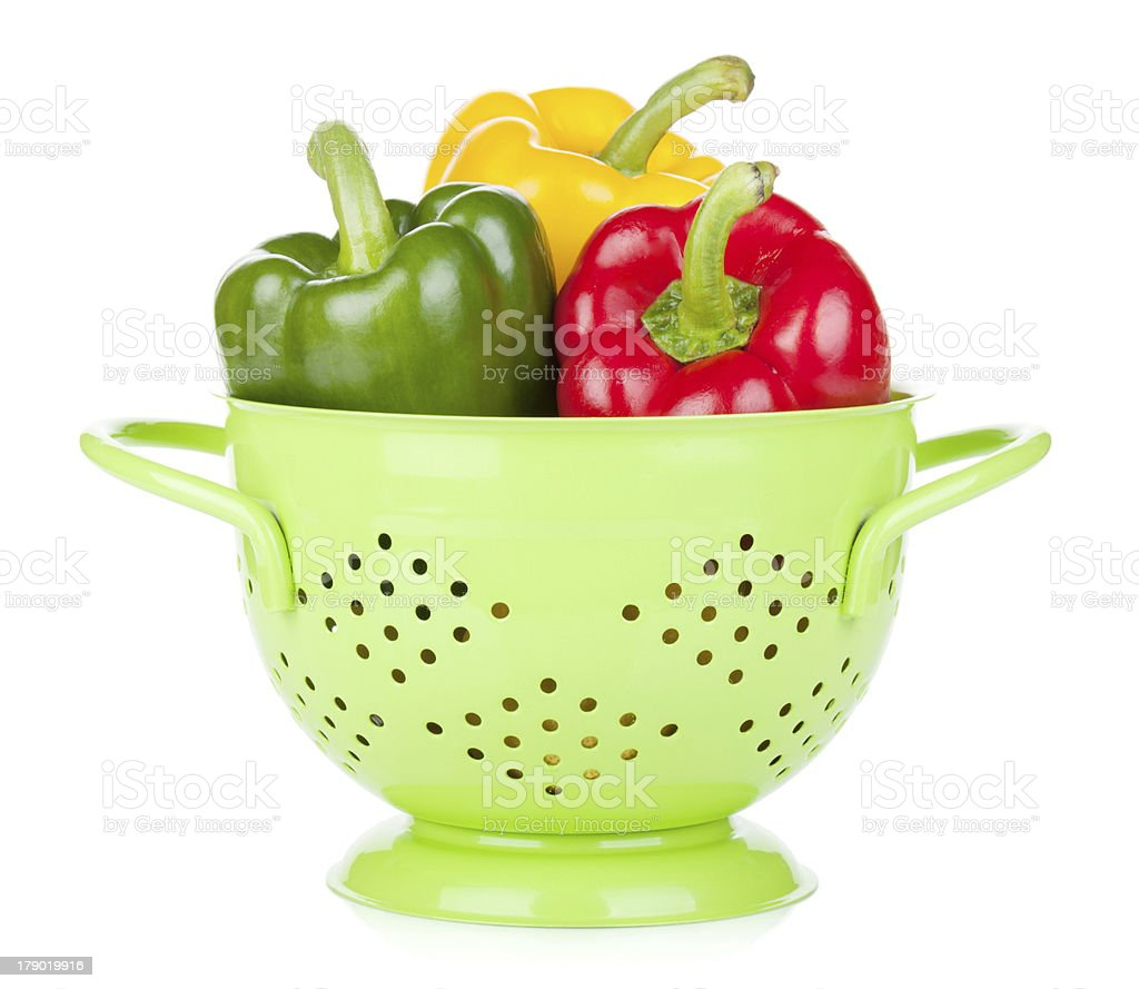 Fresh ripe bell peppers in colander royalty-free stock photo
