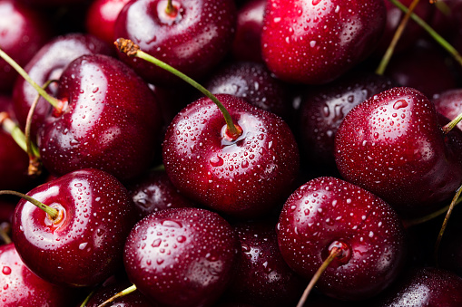 Fresh ripe black cherries background Top view Close up