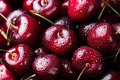 istock Fresh ripe black cherries background Top view Close up 612524020