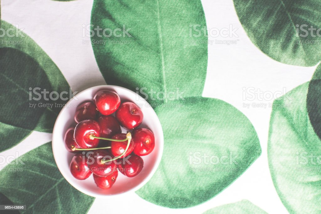 Fresh Ripe Cherries in White Bowl with Copy Space. Summer and Harvest Concept. zbiór zdjęć royalty-free
