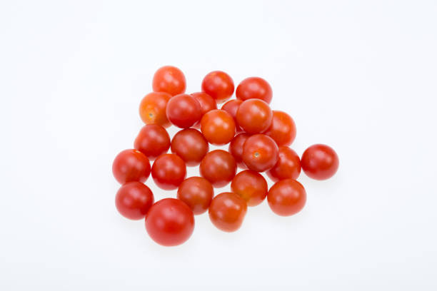 Fresh ripe cherry tomatoes isolated on a white background stock photo