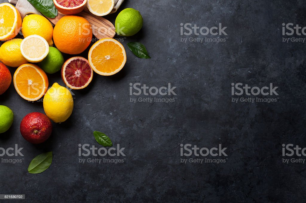 Fresh ripe citruses. Lemons, limes and oranges stock photo