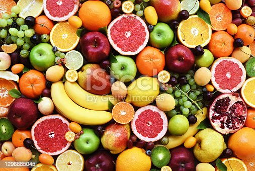Fresh ripe organic fruits from market: apple and orange, grapefruit and banana, grape and apricot
