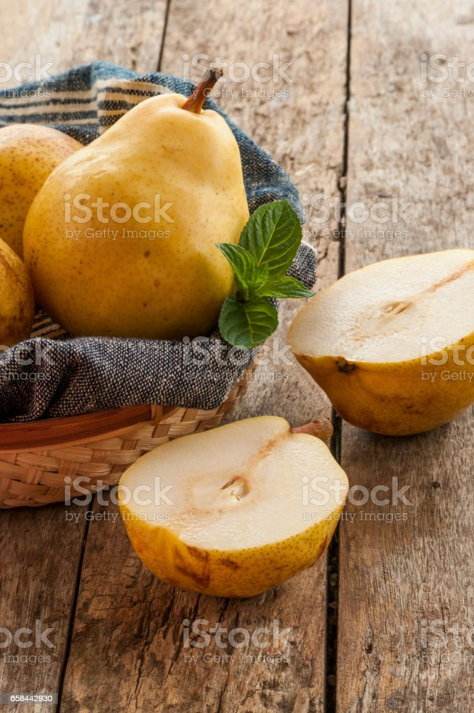 fresh ripe organic pears on a rustic wooden table close up stock photo