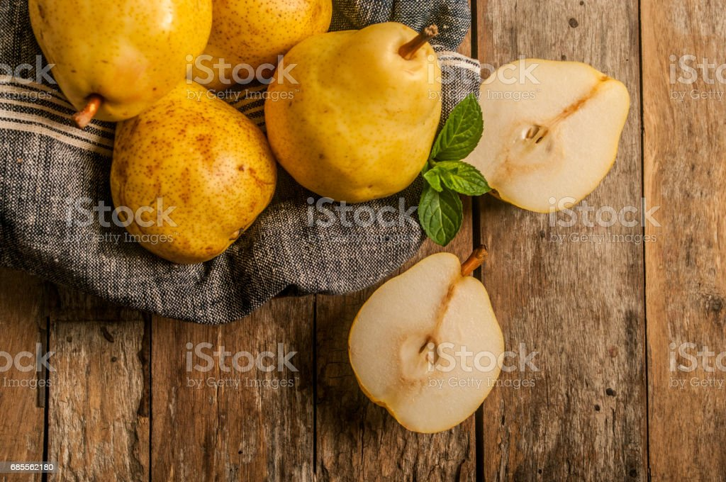 fresh ripe organic pears on a rustic wooden table 免版稅 stock photo