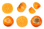 istock fresh ripe persimmons with slices isolated on white background. top view 1077515196