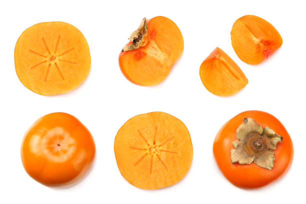 fresh ripe persimmons with slices isolated on white background. top view - diospiro imagens e fotografias de stock