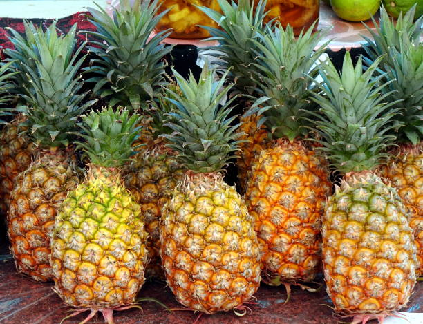 Fresh Ripe Pineapples for Sale stock photo