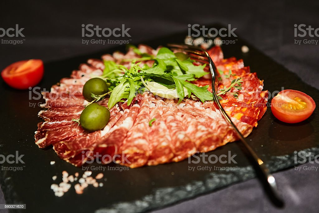 Fresh ripe salami with vegetables stock photo