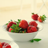 Fresh ripe strawberries in bowl on white background. Square, copy space, toned