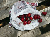 Fresh ripe sweet cherries closeup in a package on a rustic rustic table, natural summer vitamin