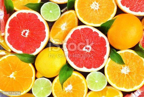 Fresh ripe sweet citrus fruits colorful background: orange, grapefruit, lime, lemon