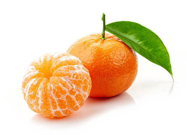 fresh ripe tangerines fresh ripe tangerines with green leaf isolated on white background tangerine stock pictures, royalty-free photos & images