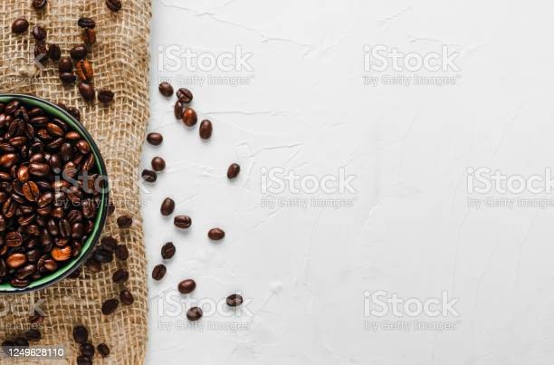 Fresh roasted coffee beans in a cup on burlap white concrete flat picture id1249628110?b=1&k=6&m=1249628110&s=612x612&h=7yer7j1ahn4e8ftg s97d6uk64d5fuzjfl6qtzh1npq=