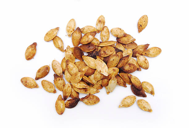 Fresh Roasted Pumpkin Seeds Isolated on White stock photo