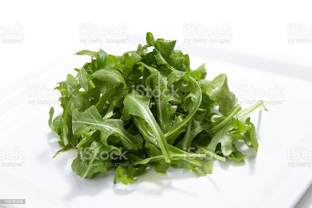 Fresh rocket salad with olive oil royalty-free stock photo