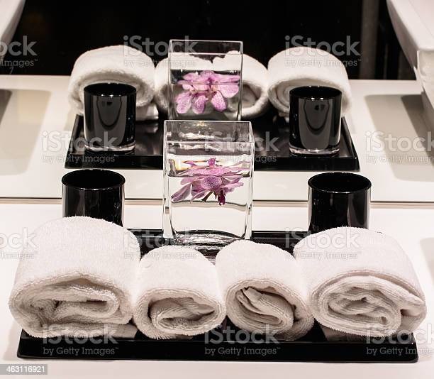 Fresh rolled towels and orchids inside a comfort room picture id463116921?b=1&k=6&m=463116921&s=612x612&h=q6k4efa5gkk6dowrpgbky32wjvuaaccx8tbjooubbai=