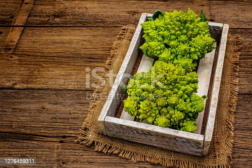Fresh Romanesco cabbage harvest. Ripe ingredient for healthy food. Old wooden boards background, copy space