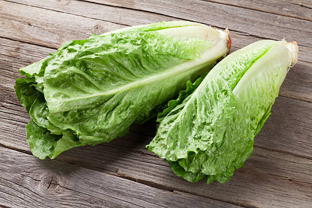 Fresh Romano salad Fresh Romano salad on wooden table romaine lettuce stock pictures, royalty-free photos & images