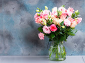 istock fresh rose flowers on gray 1131689229