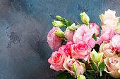istock fresh rose flowers on gray 1131689252