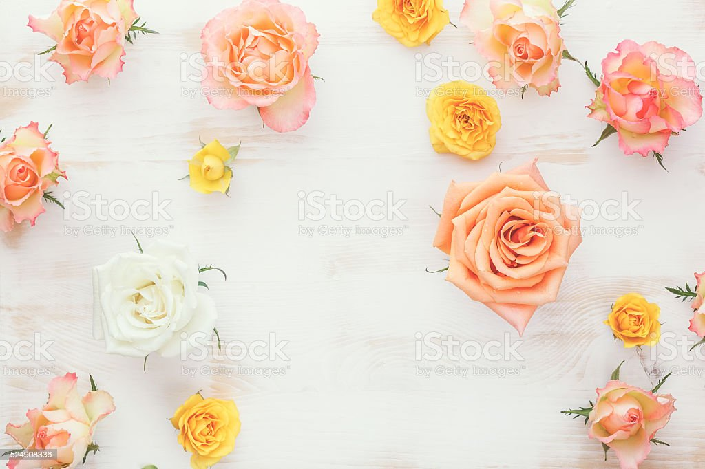 Fresh roses flower on rustic wooden table stock photo